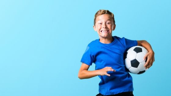 Extraverted Child Playing Soccer